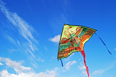 Kite flying in the sky background Stock Photography