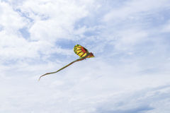 Kite flying in the sky among the clouds on the tropical Bali island, Indonesia. royalty free stock photos
