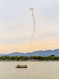 Kite flying in the sky over the Kunming lake Stock Image