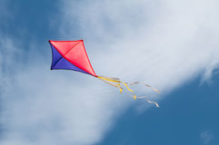 Kite flying in the sky. A red and blue kite flying in the sky Stock Photos
