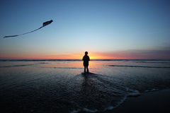 Kite flying at sunset Stock Image