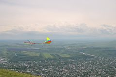 Kite flying on the top of the mountain. Kite flying on the top of the Mashuk mountain (Russia&#x29 Stock Photo