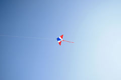 Kite flying in the wind and clear sky Royalty Free Stock Image