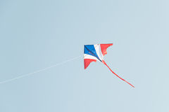 Kite flying in the wind and clear sky Royalty Free Stock Images