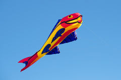 The kite in the form of fish soars in the clear blue sky Royalty Free Stock Images