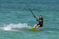 Kite girl. Young pretty woman riding a kite Stock Photo