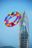Kite holiday. Chinese Guangdong Shenzhen big plum sand kite holiday. A giant a riot of color ring-like kite has fluttered slowly from the desire tower crown Royalty Free Stock Photos