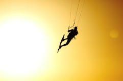 Kite jump under sunset sun Stock Photo