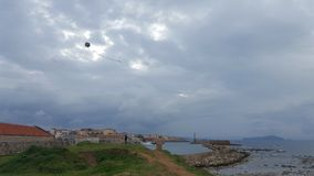 Kite. Made out off old newspaper with the port of chania in the background Royalty Free Stock Image