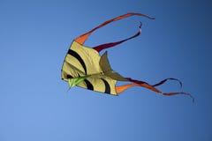 Kite in blue sky. Kite in middle of blue sky flying Stock Image