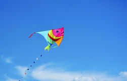 Kite over blue sky Stock Photo