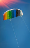 Kite rainbow colors fly high in the sky. Kite, parachute rainbow colors fly high in the sky stock photography