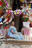 Kite seller, India. Woman in her family's storefront kite shop in Surat, India stock photo