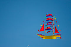 Kite in the shape of boat. Colorful kite in the shape of boat with blue sky background Stock Photo