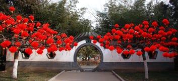 Chinese moon door with Lantern on tree stock photo