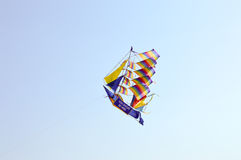 Kite-shaped boat and with rainbow Royalty Free Stock Photos