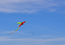 Kite in the sky. Kite flying in blue sky Royalty Free Stock Photography