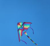 Kite in sky blue for the amusement of children Stock Photography