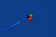 Kite in the sky. Colorful kite in blue sky on an autumn day Royalty Free Stock Photography
