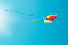 Kite on the sky. Colorful kite on the blue cloudless sky Royalty Free Stock Image