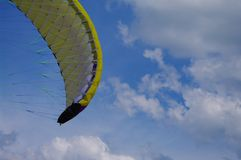 Kite sky fly. Colorful kite flying in the summer breeze stock photo