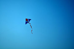 A kite on skyblue - background. A kite on the bluesky holiday afternoon at central park - thailand stock photo