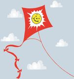 Kite smiley blue sky. A bright kite flying in a sunny sky Royalty Free Stock Photos