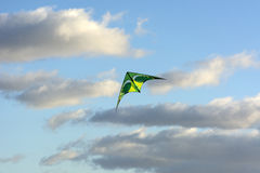 Kite soars in the clouds, blue sky, Sunny day Stock Photo