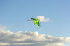 Kite soars in the clouds, blue sky, Sunny day, fly Stock Images