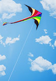 Kite soars in the sky with clouds Royalty Free Stock Images