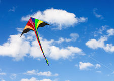 Kite soars in the sky with clouds Stock Photo