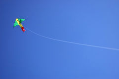 Kite and String. Kite with string attached with blue background royalty free stock images