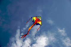 Kite on a Summer Day. A colorful kite soaring in the blue sky on a summer day Stock Images