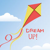 Kite in summer sky. Flying kite with a ribbons tail in a summer sky with a pair of clouds, vector illustration with motivational quote - dream up Royalty Free Stock Image