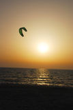 Kite in a sunset. A view of a green kite in a sunset Royalty Free Stock Image