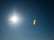 Kite surf - summer sunshine. The kite from a kite surfer soaring above in the blue sky and the bright summer sun.  Location: Vasto, Italy Royalty Free Stock Photos