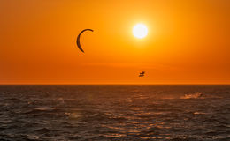 Kite surf and sunset at Mykonos island. Royalty Free Stock Image
