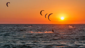 Kite surf and sunset at Mykonos island. Royalty Free Stock Photo