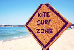 Kite surf zone. Sign on the beach that says that from now on starting kite surf zone Stock Images