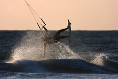 Kite Surfer. In the setting sun at Rhosneigr Isle of Anglesey North Wales Royalty Free Stock Photo