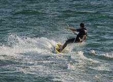 Kite Surfer. Catching waves at Sunset Beach Royalty Free Stock Photography