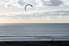 Kite Surfer. / Boarder with sky behind on a windy day having trouble keeping hold Royalty Free Stock Photo