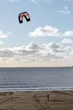 Kite Surfer. / Boarder with sky behind on a windy day trying to get on to the board Stock Photography
