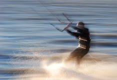 Kite-surfer. Kite surfer goes fast blurred motion Stock Photo