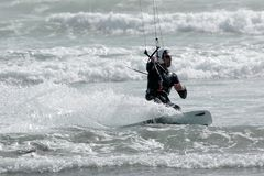 Kite Surfer 4. Kite surfer ( kite boarder ) riding the waves  near Cayucos, California Stock Image