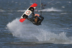 Kite Surfer. In mid-somersault royalty free stock photos