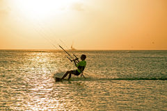 Kite surfer on Aruba island in the Caribbean at sunset. Kite surfer on Aruba island in the Caribbean sea at sunset royalty free stock photo