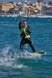Kite surfer on the beach in Costa Brava town Palamos of Spain. 10. 03. 2018 Spain royalty free stock photo