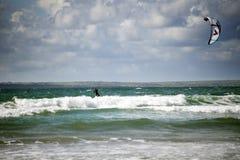 Kite surfer on beautiful storm waves Stock Photos