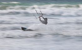 Kite Surfer / Boarder. Going fast with spray. Shot at low shutter speed and tracked giving good feeling of speed Royalty Free Stock Photos